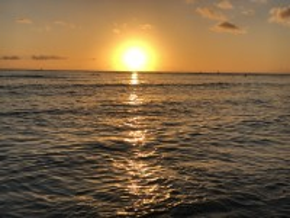 Собирать пазл Sunset over ocean онлайн